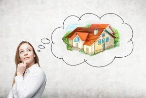 A woman thinking about property investment
